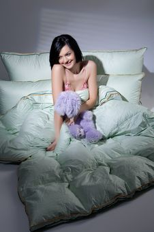 Free Woman, Blanket And Pillows Royalty Free Stock Image - 9877186