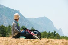 Free Tired Hiker Relaxes On A Hill Stock Photo - 9878740