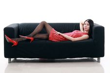 Free Asian Girl  Lying On Sofa Stock Images - 9878794