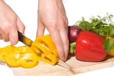 Cheaf Cutting Yellow Pepper Stock Photo