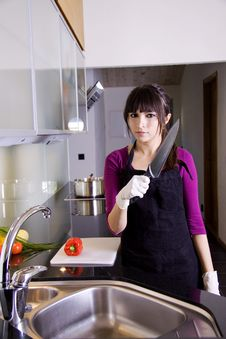 Free House Wife With A Knife In Her Hand Royalty Free Stock Photos - 9879608