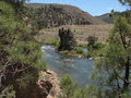 Free River Flows By Rocks And Trees Royalty Free Stock Image - 9883686