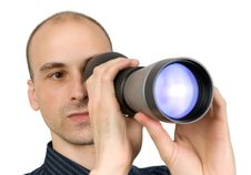 Free Man Looking Through Spyglass Stock Images - 9880414
