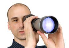 Man Looking Through Spyglass Stock Images