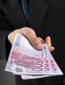 Free Businessman Holding Euros Royalty Free Stock Image - 9880456