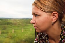 Free Young Woman Looking In The Window Of A Train Stock Image - 9880691