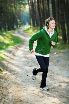 Free Girl Runner In The Forest Stock Photo - 9880920