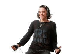 Young Man Listens To Music In Ear-phones. Royalty Free Stock Images