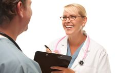 Free Male And Female Doctors Talking Stock Photography - 9885462