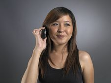 Beautiful Young Asian Woman On The Phone Royalty Free Stock Image