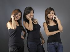 Free Three Young Ladies On The Phone Royalty Free Stock Images - 9886799