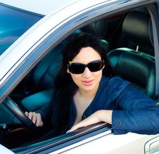 Beautiful Young Businesswoman In Her Car Royalty Free Stock Photography