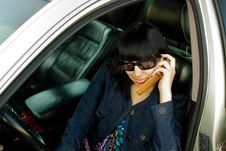 Attractive Young Woman Calling By Cellular Phone Royalty Free Stock Photo