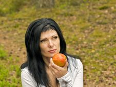 Free Girl Eats Ripe Apple Stock Photo - 9887720
