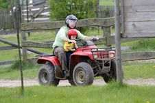 Free Dad With Son Riding A Quad Royalty Free Stock Photos - 9888388