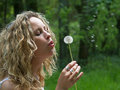 Free Curly Girl Blows Dandelion Royalty Free Stock Images - 9897589
