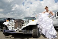 Beauty Bride Woman With Limousine Royalty Free Stock Photos