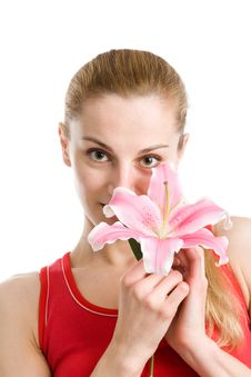 Nice Girl With A Pink Lily Royalty Free Stock Photo