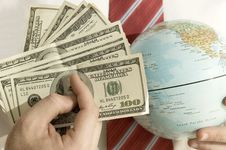 Free Many Banknotesand A Globe Stock Images - 9894134
