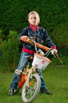 Free Young Girl And Bike Royalty Free Stock Image - 9895596