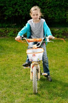 Free Young Girl And Bike Stock Images - 9895644