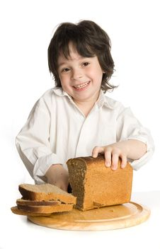 Free The Liitle Boy Wich Slicing A Bread On Desk Stock Photo - 9895660