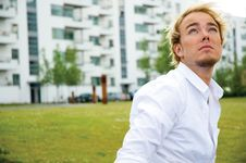 Free Young Man In Front Of White Buildings Royalty Free Stock Images - 9896029