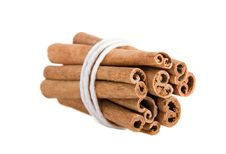 Bundle Of Cinnamon Sticks On The White Background Stock Photo