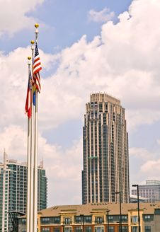 Buildings And Flags Against Sky Stock Images
