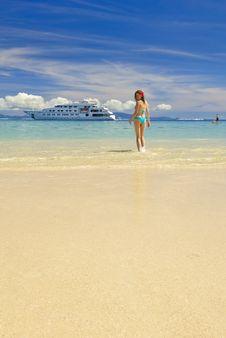 Free Girl On A Sandy Beach Royalty Free Stock Photos - 9898398