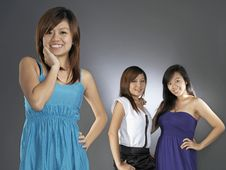 Free Three Asian Girls Comparing With Each Other Royalty Free Stock Images - 9898909