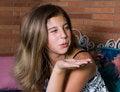 Free Pretty Teenage Girl Blowing A Kiss Stock Image - 991901