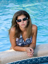 Free Pretty Teenage Girl In A Pool Wearing Sunglasses Stock Photography - 991932