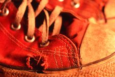 Red Tennis Shoe With Worn Through Toe Area Royalty Free Stock Photo