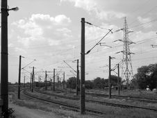 Free Industrial High Voltage Power Lines And Train Tracks Stock Photos - 997263