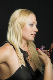 Attractive Blond Model On Black Background Have Makeup Applied Royalty Free Stock Photography