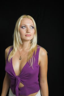 Attractive Blond Model On Black Background - Violet Top Royalty Free Stock Images