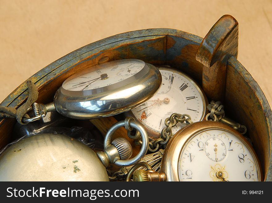 Wooden box with old pocket watches