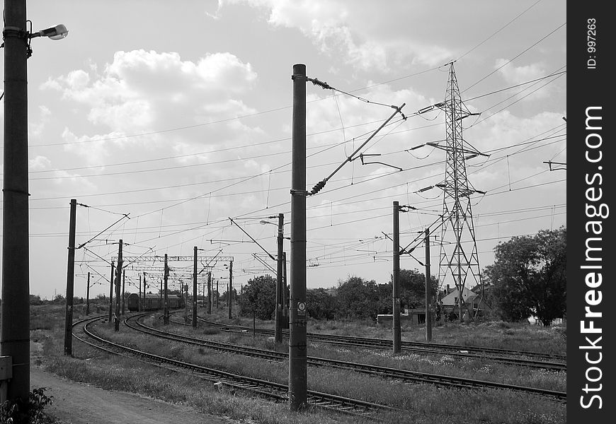 Industrial high voltage power lines and train tracks