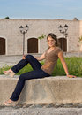 Free Girl With Blue Jeans Sitting And Relaxing Royalty Free Stock Image - 9906916