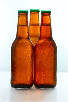 Free Three Beer Bottles Abreast Royalty Free Stock Image - 9902976