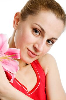 Nice Girl  With A Pink Lily Royalty Free Stock Photos