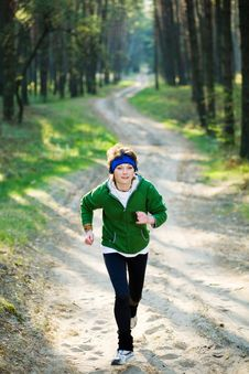 Free Girl Runner In The Forest Stock Images - 9906374