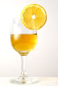 The Drink In The Glass With An Orange Stock Image