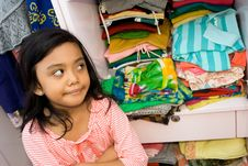 Free Little Girl And Her Clothing Collection Royalty Free Stock Images - 9908439
