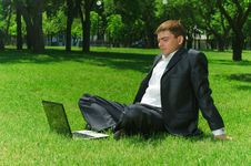 Free Young Businessman In The Park Stock Photography - 9909092