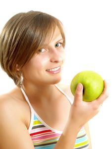 Free Beautiful Girl With A Green Apple Stock Photography - 9909252