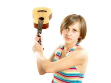 Angry Young Blond Lady Fighting With A Guitar Stock Photo