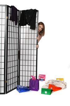 Shopping Teen Peeking From Behind A Screen Stock Image