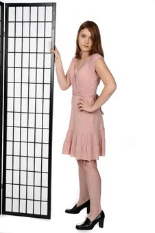 Free Pretty Teen In Pink Dress Standing Next To Screen Stock Photography - 9909742